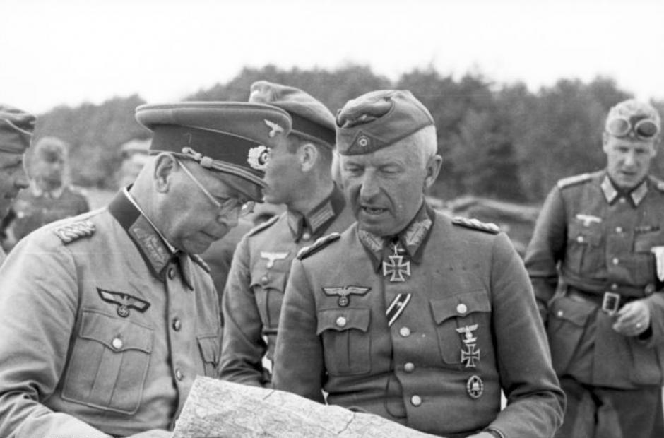 Field Marshall Erich von Manstein & General Erich Brandenberger on the Eastern Front studying a map.